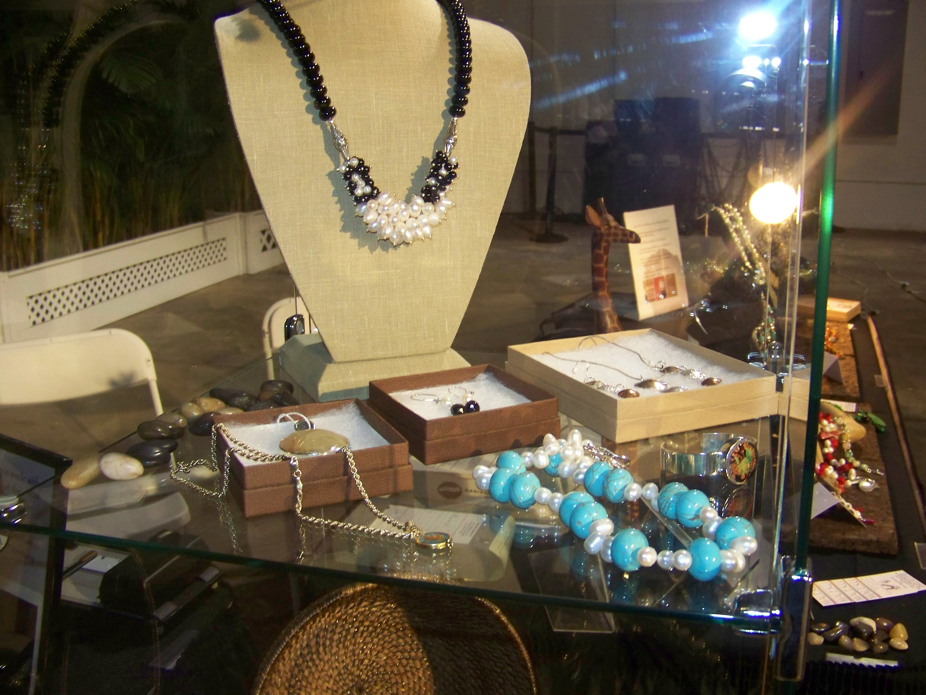 Maleku Jewelry necklace display at Miami Fashion Week