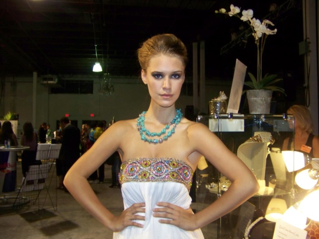 Model wearing a turquoise necklace by Maleku Jewelry at Miami Fashion Week