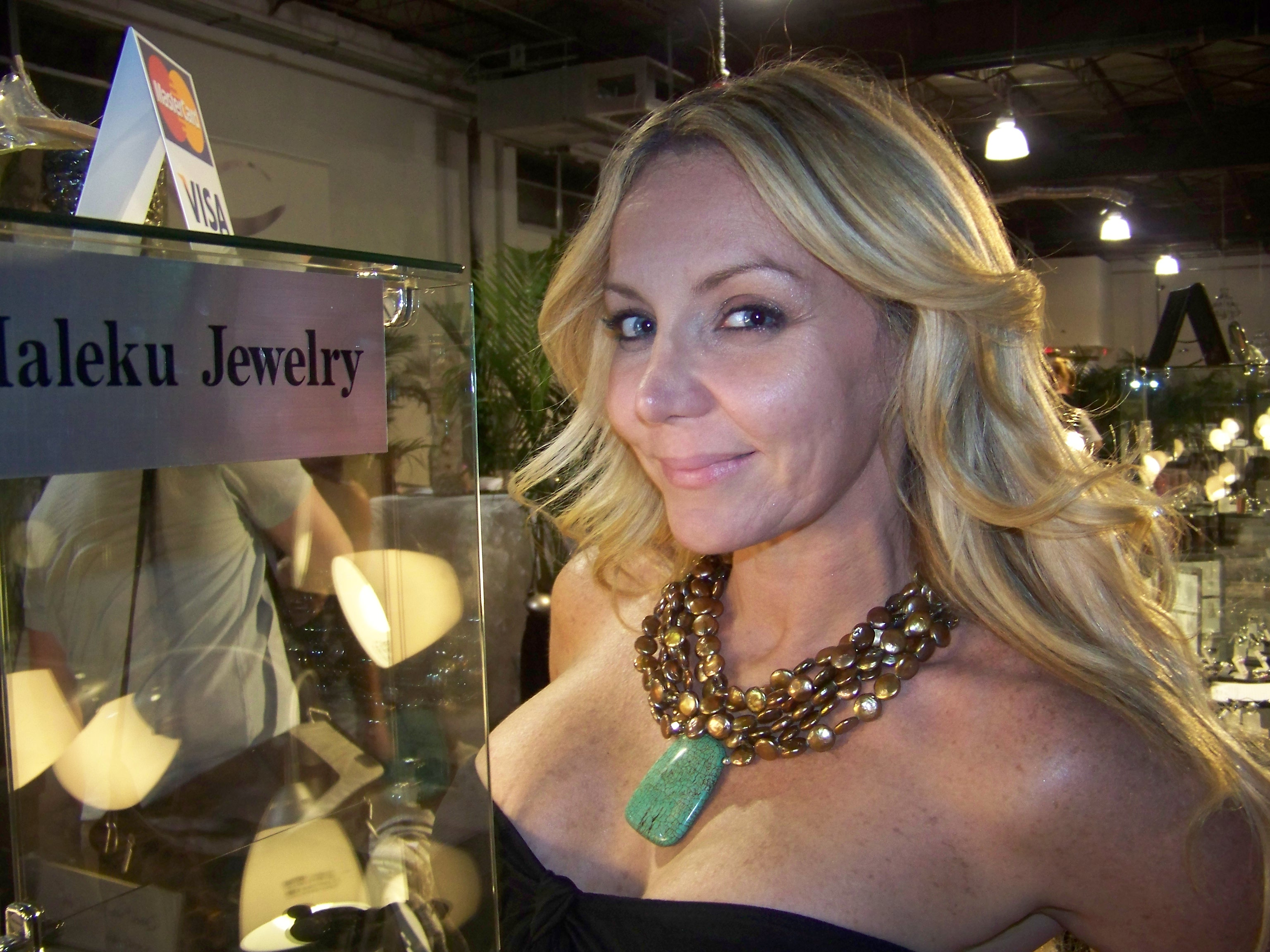 Blonde wearing turquoise and copper necklace by Maleku Jewelry at Miami Fashion Week