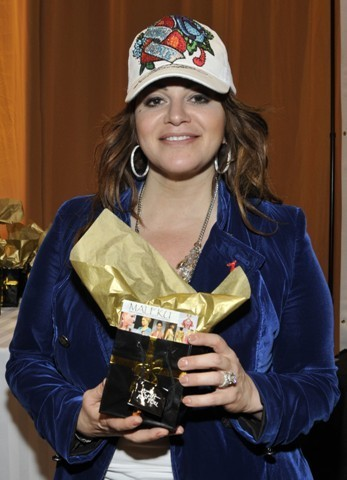 Jenni Rivera posing with Maleku Jewelry at the Latin Grammy Awards