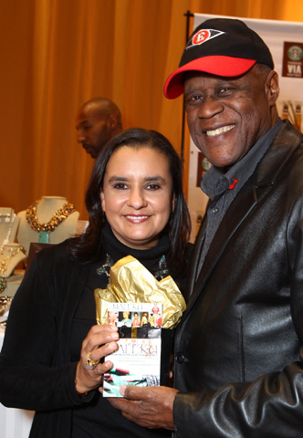 Johnny Ventura and Ileana Maleku posing with Maleku Jewelry at the Latin Grammy Awards