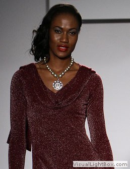 model wearing a silver necklace by Maleku Jewelry at Miami International Fashion Week