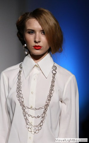Model wearing silver chain necklace by Maleku Jewelry at Miami International Fashion Week