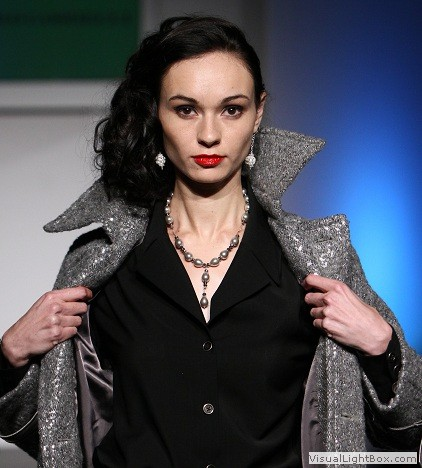 Model wearing necklace and earrings by maleku Jewelry at Miami International Fashion Week