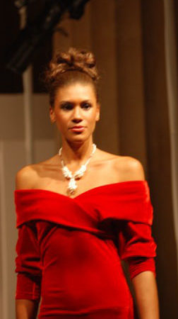 Kabuiu Red Gown Model wearing Maleku Jewelry necklace at Nolcha Fashion Week 2010
