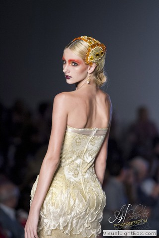 Runway model in gold wearing Maleku Jewelry accessories at Miami International Fashion Week