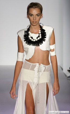 Model in White wearing Maleku Jewelry necklace at Nolcha Fashion Week 2011