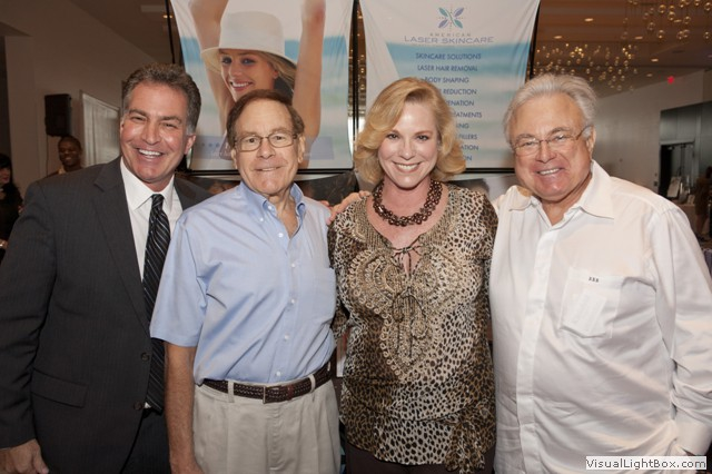 Aaron Perry, Howard Rothstein, Beth Sobol and Ronnie Rothstein posing at the Miami International Bridal Week