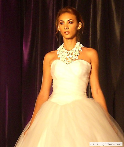 model in a wedding gown wearing a Maleku Jewelry necklace at Miami International Bridal Week