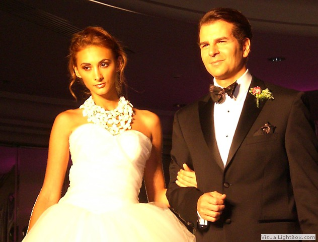 Bride and Groom models wearing a Maleku Jewelry necklace at Miami International Bridal week
